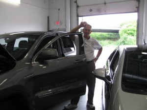 Owner and DIY Solar Consultant prepares for test drive of Jeep Cherokee Electric Conversion