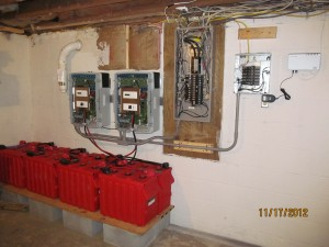Battery bank, inverters and emergency breaker panel on DIY Solar installation
